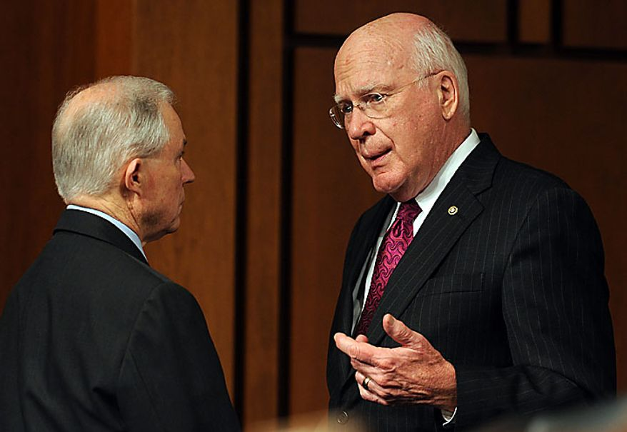 Committee Chair Sen. Patrick Leahy, Vermont Democrat (right), speaks with ranking member Sen. Jeff Sessions, Alabama Republican, as Supreme Court nominee Elena Kagan, President Obama's pick to replace retiring Justice John Paul Stevens, testifies on the third day of her confirmation hearing before the Senate Judiciary Committee on Capitol Hill in Washington on June 30, 2010.    UPI/Roger L. Wollenberg