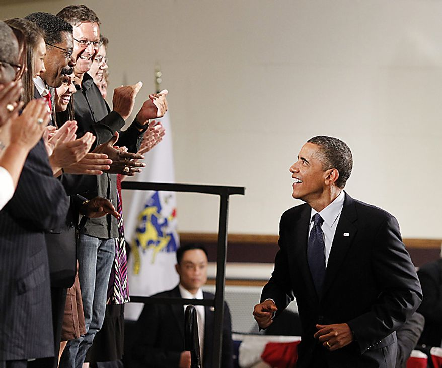 U.S. President Barack Obama is applauded as he takes the stage for a town hall style meeting at Memorial Hall in Racine, Wisconsin on June 30, 2010.     UPI/Brian Kersey
