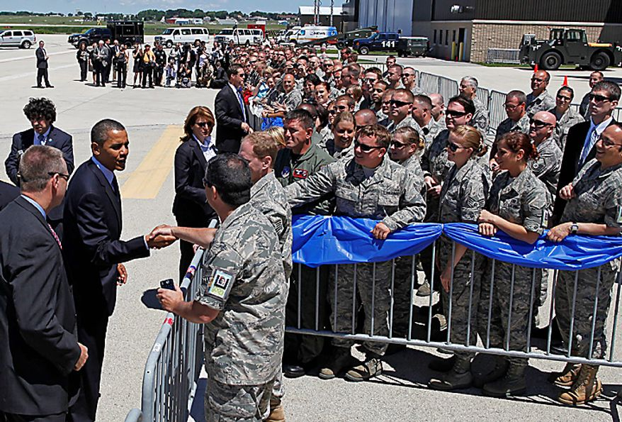 President Barack Obama greets members of the Wisconsin National Guards 128th Air Refueling Wing upon his arrival at Mitchell International airport in Milwaukee, Wis., Wednesday, June, 30, 2009.  (AP Photo/Jeffrey Phelps)