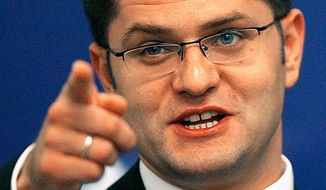 Serbian Foreign Minister Vuk Jeremic gestures during a press conference in Bucharest, Romania, Tuesday, Sept. 4, 2007. (AP Photo/Vadim Ghirda)