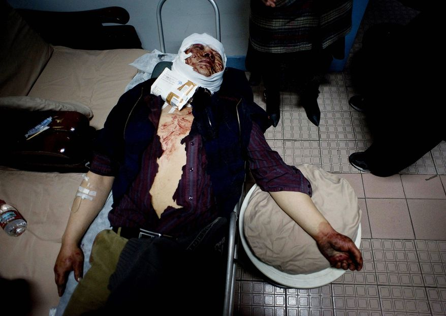 Jiang Yingjie recovers in a Beijing hospital in 2009 after being beat by assailants he said were police trying to evict him from his restaurant, which was forcibly closed and set for demolition.