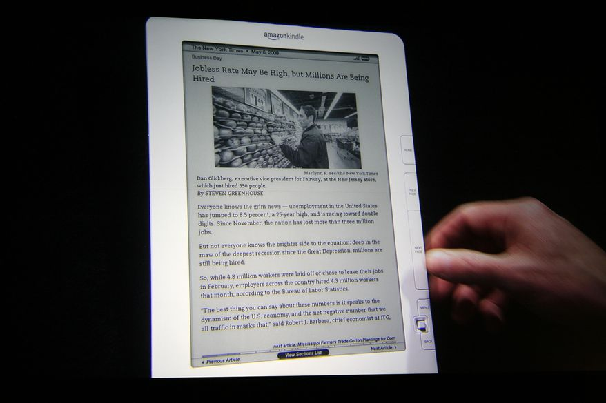 ** FILE ** In this file photo taken May 6, 2010, the Kindle DX, displaying a page from The New York Times, is demonstrated at a news conference in New York. Online retailer Amazon.com Inc. said Thursday, July 1, 2010, that it is introducing a new version of its higher-end Kindle at a lower price as competition among electric-book readers intensifies. (AP Photo/Mark Lennihan, file)