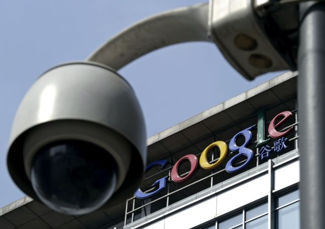 In this March 23, 2010, file photo, a surveillance camera is seen in front of the Google China headquarters in Beijing. Google Inc. said one of its Web search features was blocked in China on Thursday, July 1, 2010, as the company awaited Beijing's decision on whether to renew its operating license in their latest skirmish over censorship. (AP Photo/Andy Wong, File)