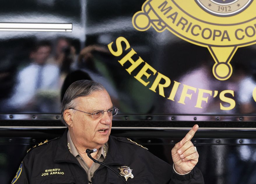 ** FILE ** In this April 29, 2010 file photo, Maricopa County Sheriff Joe Arpaio answers questions at a news conference to announce his latest crime suppression enforcement patrols in Phoenix. Arizona officials are releasing a training program designed to teach police officers to enforce a tough new crackdown on illegal immigration without racially profiling. (AP Photo/Ross D. Franklin, File)