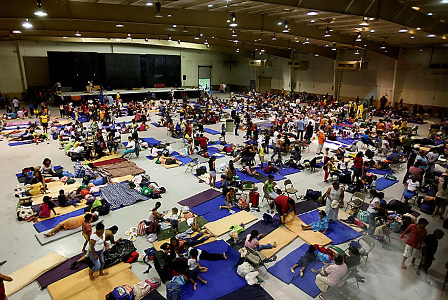 Evacuees pictured inside a convention center being used as a shelter several hours before the expected arrival of Hurricane Alex, the first Atlantic hurricane of the year, in Matamoros, northeastern Mexico, on the border with Texas on Wednesday, June 30, 2010. (AP Photo/Eduardo Verdugo)