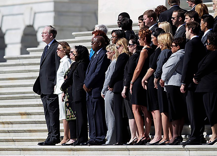 Sen. Jay Rockefeller, West Virginia Democrat, left, and others, watch as the casket containing the remains of Sen. Robert C. Byrd, West Virginia Democrat, is carried up the Senate steps on Capitol hill in Washington, Thursday, July 1, 2010. (AP Photo/Carolyn Kaster)