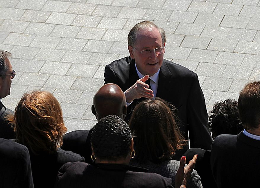 Sen. Jay Rockefeller, West Virginia Democrat, greets staff members of the late Sen. Robert C. Byrd, West Virginia Democrat, as they wait for the arrival of his casket on Capitol  Hill in Washington, Thursday,  July, 1, 2010.  (AP Photo/Bill O'Leary, Pool)
