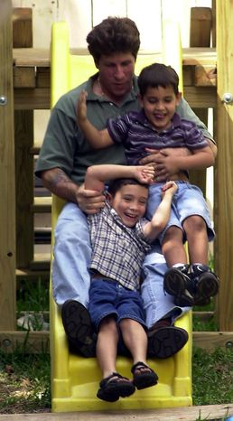 Possible break-thru in the Elian Gonzalez case ... Elian (bottom) plays with Donato Dalrymple, the man who while fishing Thanksgiving day, found Elian's group floating off the Florida coast. They are with an unidentified cousin, April 3, 2000. ( Sean Dougherty / The Washington Times )