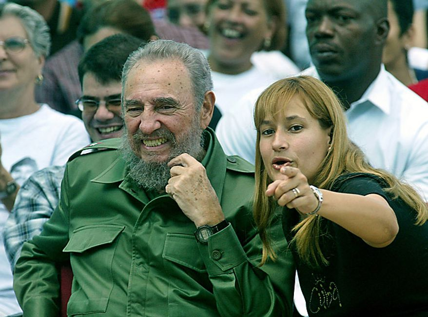 Cuban leader Fidel Castro  reacts as he attends Elian Gonzalez's 9th birthday activities, Cardenas, east of Havana,  Friday, Dec.06, 2002.  Life has never been the same for the child since an ill-fated attempt to take him to the United States left his mother dead and made him the focus of an international tug-of-war between relatives in Miami and his father in Cardenas. On the right is Miriam Janet Martinez leader of the Cuban Pioneers.  (AP Photo/Jose Goitia)