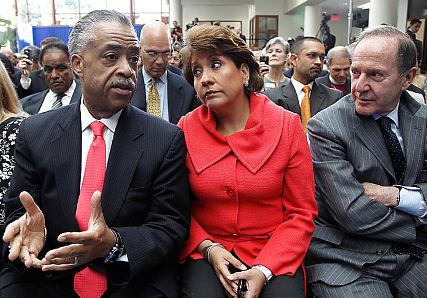 From left, Rev. Al Sharpton, Janet Murguia, president and CEO, National Council of La Raza, and Mort Zuckerman, chief executive officer of U.S. News and World Report, wait for President Obama, who spoke about immigration reform, Thursday, July 1, 2010, at American University in Washington. (AP Photo/Charles Dharapak)