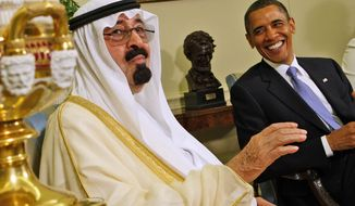 **FILE** President Obama and Saudi Arabia's King Abdullah share a light moment when they met on June 29, 2010, in the Oval Office of the White House in Washington. (Associated Press)