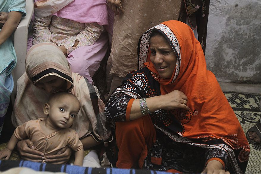 Pakistani women mourn the death of their family members in Thursday night attack in Lahore, Pakistan in Lahore, Pakistan on Friday, July 2, 2010. Two suicide bombings that killed 42 at a popular Sufi shrine in Lahore stirred outrage in this terror-scarred nation Friday. (AP Photo/K.M.Chaudary)