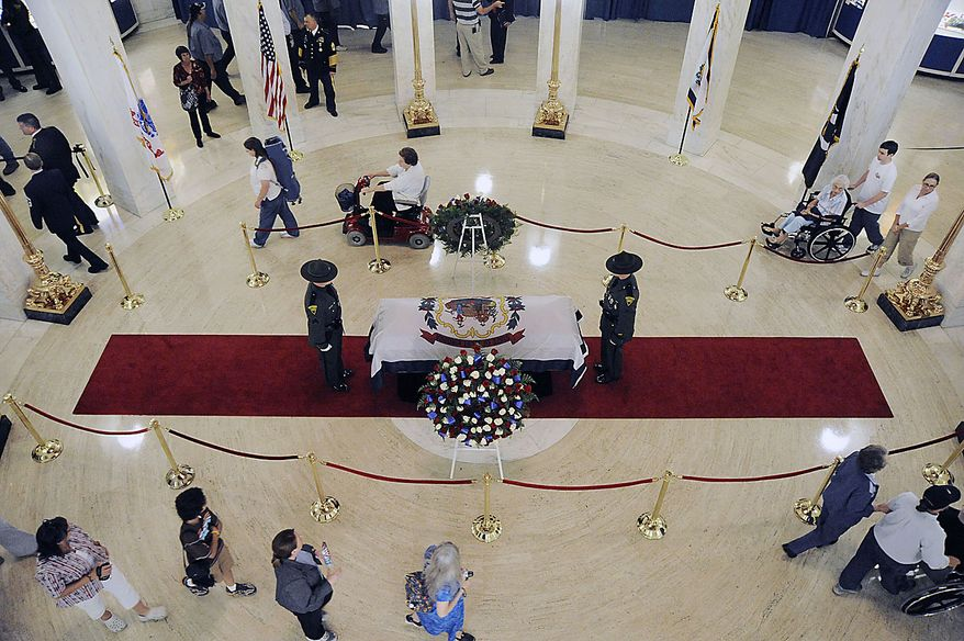 Visitors walk by the casket of Sen. Robert C. Byrd Thursday, July 1, 2010, Charleston, W.Va. Mr. Byrd will lie in repose overnight at the Capitol until Friday morning when a memorial service will be held. (AP Photo/Jeff Gentner)