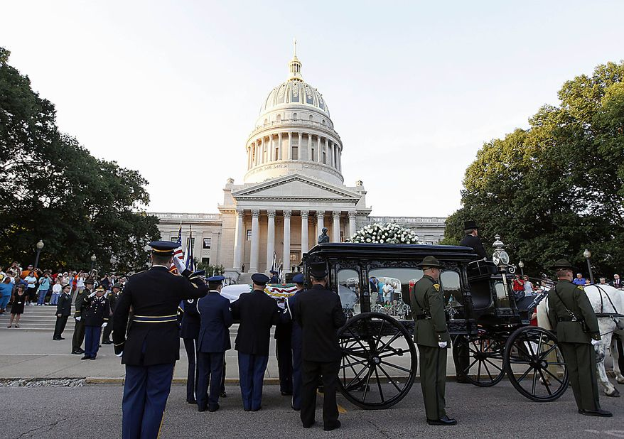 The casket containing the body of the late Sen. Robert C. Byrd is removed by an honor guard at the Capitol in Charleston, W.Va., Thursday, July 1, 2010.  Mr. Byrd will repose at the Capitol until Friday morning when a memorial service will be held.  (AP Photo/Steve Helber)