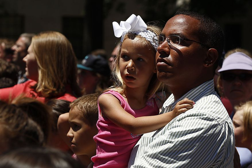 An unidentified man and girl stand during a memorial service for Sen. Robert Byrd, Friday, July 2, 2010, at the Capitol in Charleston, W.Va. (AP Photo/Charles Dharapak)