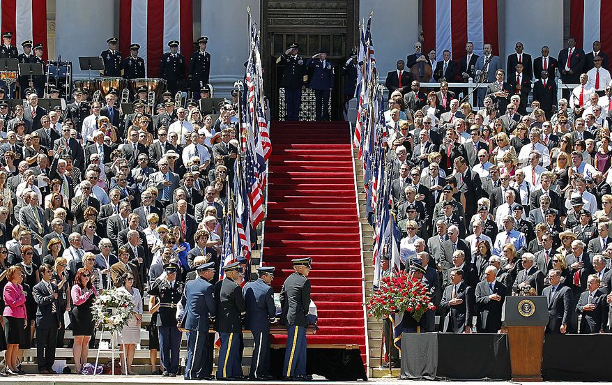 An honor guard carries the casket of  Sen. Robert Byrd into place during a memorial service at the Capitol in Charleston, W.Va., Friday July 2, 2010. (AP Photo/Gene J. Puskar)