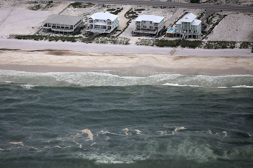 A huge oil slick approaches the beach in Gulf Shores, Ala., Friday, July 2, 2010. Oil from the Deepwater Horizon incident is expected to come ashore over the July 4th weekend. (AP Photo/Dave Martin)