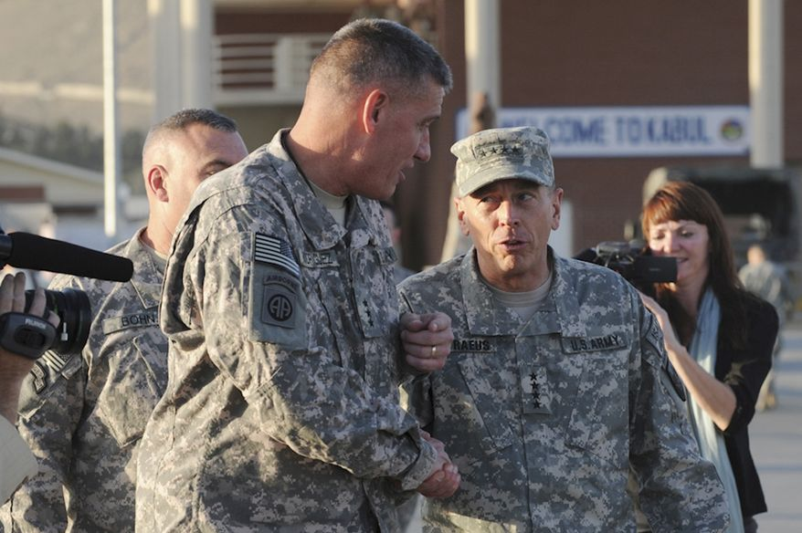 ** FILE ** Gen. David H. Petraeus (center right), the newly appointed International Security Assistance Forces commander, greets Lt. Gen. David Rodriguez upon Gen. Petraeus' arrival in Kabul, Afghanistan, in July 2010 to take command of U.S. and international forces fighting the nearly 9-year-old war. (AP Photo/Staff Sgt. Daylena Gonzalez, U.S. Air Force)