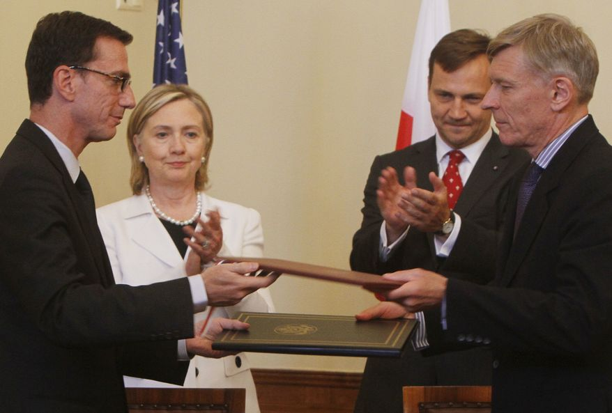 U.S. Secretary of State Hilary Rodham Clinton, second left, and Poland's Foreign Minister Radek Sikorski, third left, applaud as documents are exchanged after the signing of a protocol adjusting a 2008 missile defense agreement to meet its new shape decided by the Obama administration, in Krakow, Poland, on Saturday, July 3, 2010. (AP Photo/Czarek Sokolowski)