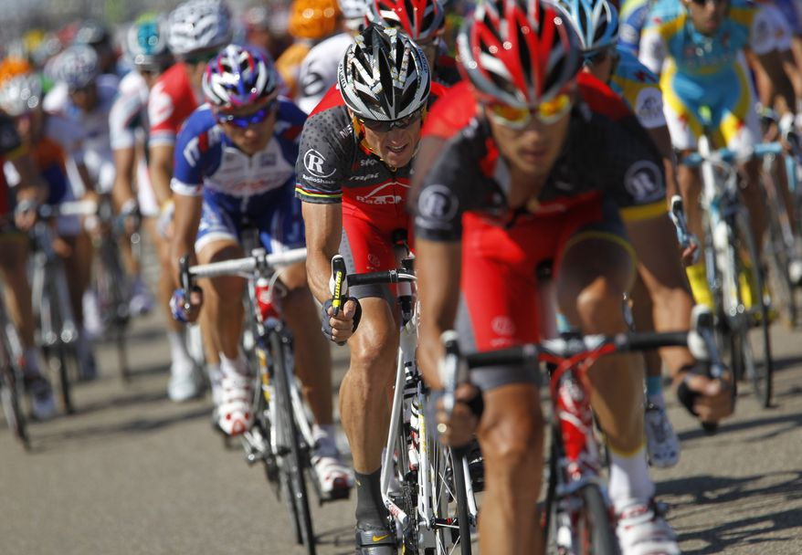 ASSOCIATED PRESS Lance Armstrong of the US, center, rides in the pack during the first stage of the Tour de France cycling race over 223,5 kilometers (139 miles) with start in Rotterdam, Netherlands and finish in Brussels, Belgium, Sunday July 4, 2010.