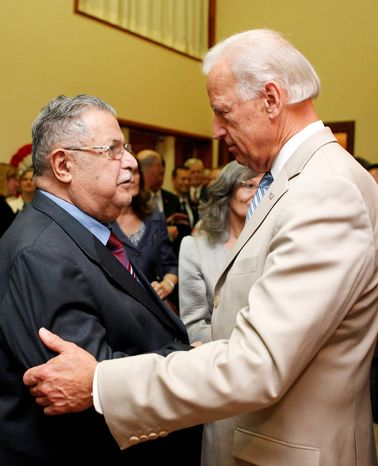"""Vice President Joseph R. Biden Jr. speaks with Iraqi President Jalal Talabani at the U.S. Embassy in Baghdad on Sunday. Mr. Biden spoke with other Iraqi leaders and said """"all are going to have to play a meaningful role in this new government."""" (Associated Press)"""