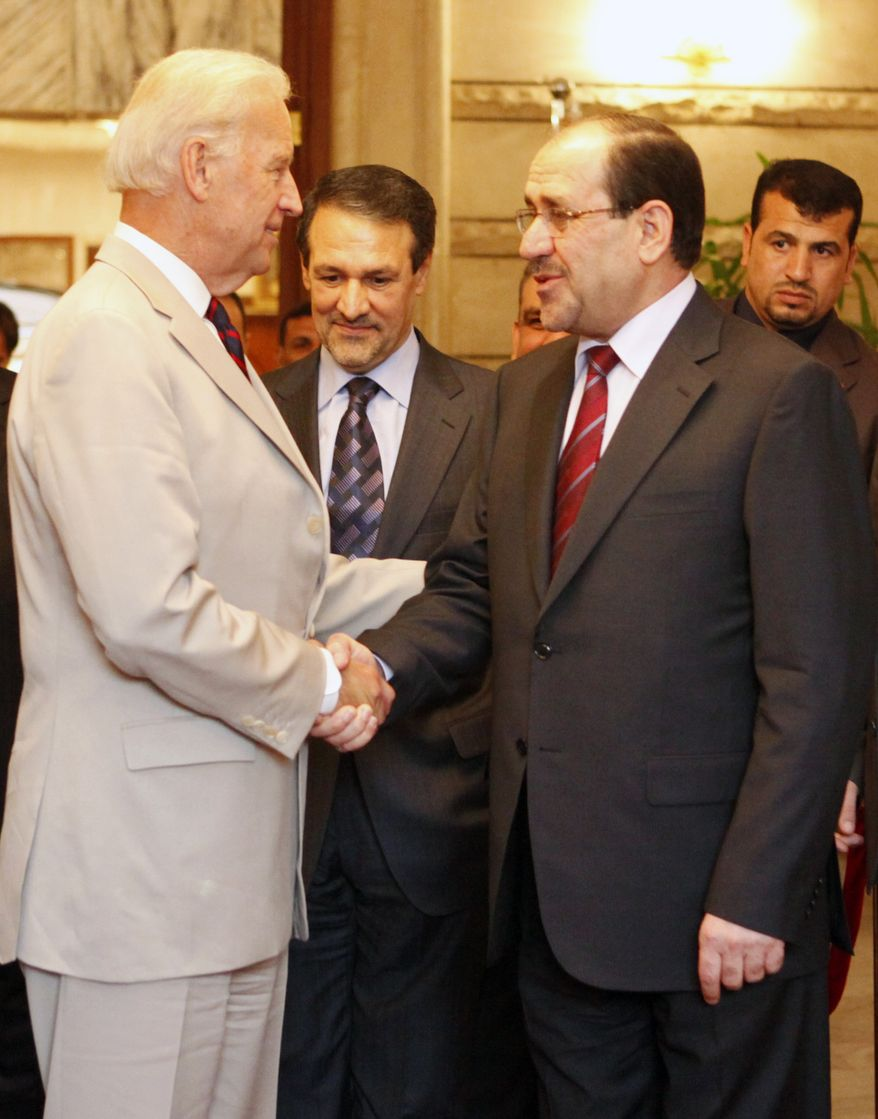 Vice President Joe Biden (left) speaks Sunday with Iraqi Prime Minister Nouri al-Maliki (right) as Iraqi government spokesman Ali al-Dabbagh (center) looks on in Baghdad, Iraq. Biden said all political blocs must be included in the new Iraqi government in order for it to succeed. (Associated Press)