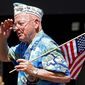 Pearl Harbor survivor Cecil Malmin salutes during the 4th of July parade Sunday, July 4, 2010, in Alameda, Calif. (AP Photo/Ben Margot)