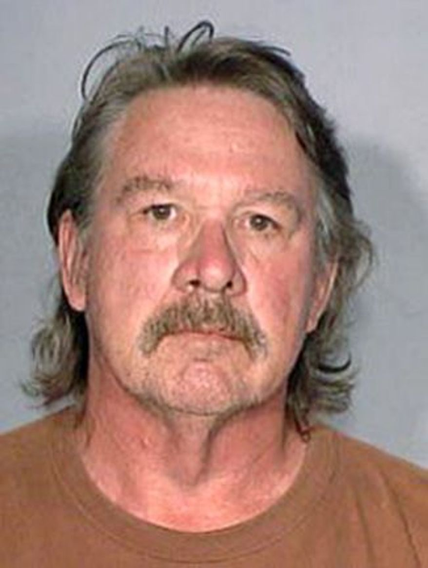 Russell Haas has a July 22 court date as a result of his attempt to get a Hawaii County police officer to accept census forms. (Hawaii County Police Department via Associated Press)
