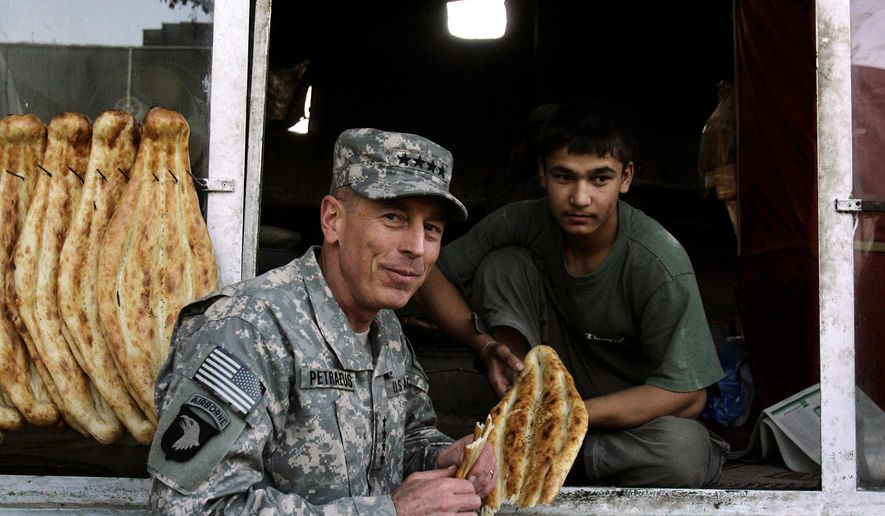 "Gen. David H. Petraeus, the new commander of U.S. and NATO forces in Afghanistan, grabs a bite at a bakery in Kabul, Afghanistan. President Obama said about Gen. Petraeus, ""I'm extraordinarily grateful that he has agreed to serve in this new capacity."" (Associated Press)"