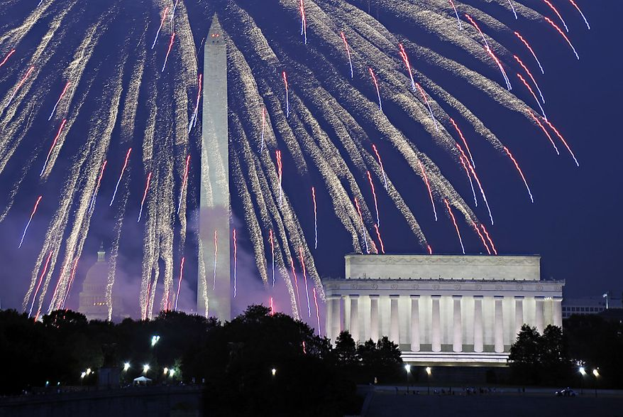 **FILE** Fireworks explode over Washington as the United States celebrates its 234th birthday on Sunday, July 4, 2010. Seen from left is the U.S. Capitol, Washington Monument and Lincoln Memorial. (AP Photo/Cliff Owen)