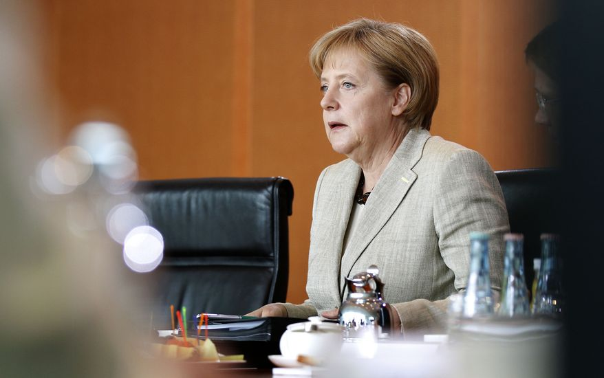 German Chancellor Angela Merkel reacts at the beginning of a special budget meeting of the cabinet at the chancellery in Berlin, Germany, Sunday, June 6, 2010. Chancellor Angela Merkel met with her ministers to hammer out a savings plan for the nation's budget that could include cuts to federal staff, social welfare benefits or tax hikes. (AP Photo/Michael Sohn)
