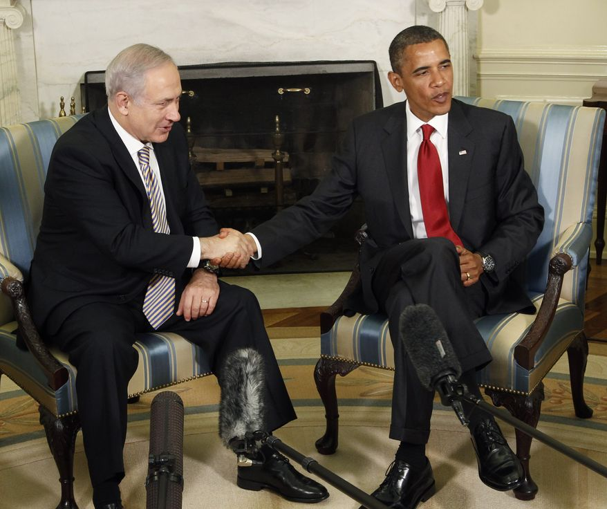 Israeli Prime Minister Benjamin Netanyahu meets Tuesday with President Barack Obama in the Oval Office of the White House. (Associated Press)