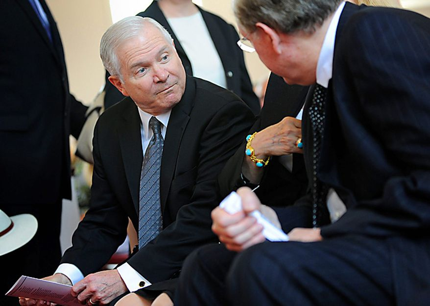 Defense Secretary Robert Gates, left, talks with Sen. Jay Rockefeller, D-W.Va., during a funeral service for Sen. Robert Byrd, Tuesday, July 6, 2010, at the Memorial Baptist Church in Arlington, Va.  (AP Photo/Linda Davidson, Pool)