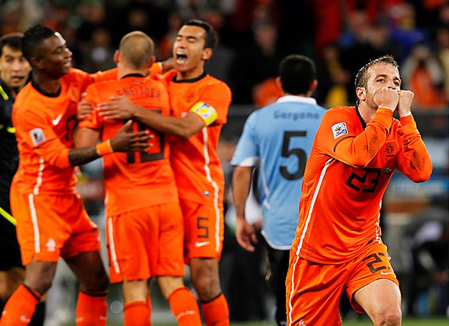 Netherlands' Rafael van der Vaart, foreground right, and fellow team members Eljero Elia, left, Wesley Sneijder, second from left, and Giovanni van Bronckhorst, third from left, celebrate following the World Cup semifinal soccer match between Uruguay and the Netherlands at the Green Point stadium in Cape Town, South Africa, Tuesday, July 6, 2010. The Netherlands won 3-2.  (AP Photo/Eugene Hoshiko)