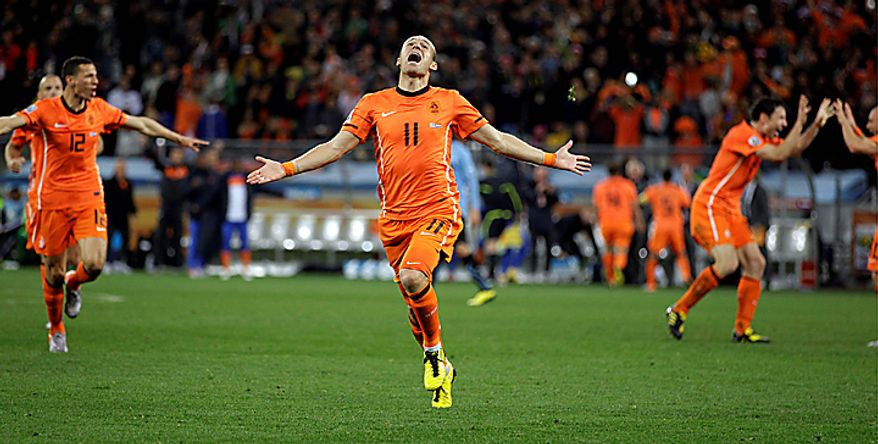 Netherlands' Arjen Robben celebrates after socring his side's third goal during the World Cup semifinal soccer match between Uruguay and the Netherlands at the Green Point stadium in Cape Town, South Africa, Tuesday, July 6, 2010.  (AP Photo/Fernando Vergara)
