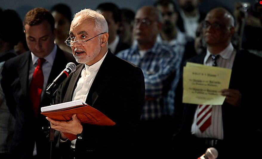 Imam Feisal Abdul Rauf, executive director of the Cordoba Initiative, addresses a gathering as groups planning a proposed mosque and cultural center near Ground Zero in Lower Manhattan to be named Cordoba House showed and spoke about their plans for the center at a community board meeting in New York Tuesday, May 25, 2010. Community members both for and against the plan spoke during the meeting.  (AP Photo/Craig Ruttle)