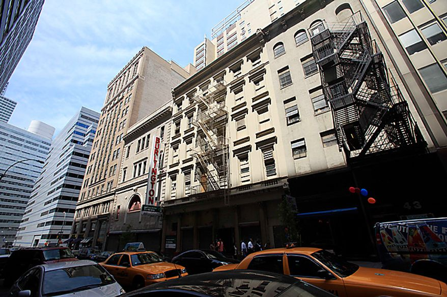 ** FILE ** Traffic passes a building in lower Manhattan that once housed a Burlington Coat Factory store. A 13-story mosque and Islamic cultural center is planned to replace the building, which was damaged by airplane debris on Sept. 11, 2001. (AP Photo/Mark Lennihan)