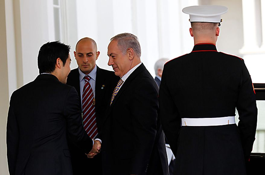 Israeli Prime Minister Benjamin Netanyahu arrives at the West Wing of the White House in Washington, Tuesday, July 6, 2010, for a meeting with President Barack Obama. (AP Photo/Pablo Martinez Monsivais)