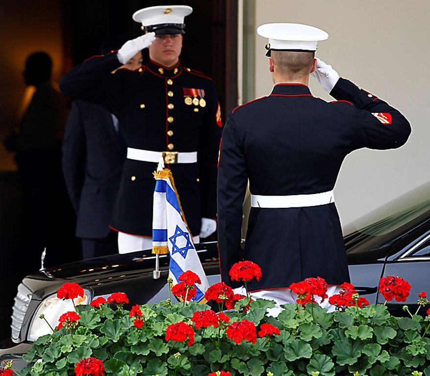 Marine honor guards salute as the limousine carrying Israeli Prime Minister Benjamin Netanyahu arrives for a meeting with President Barack Obama, Tuesday, July 6, 2010, at the White House in Washington. (AP Photo/Charles Dharapak)