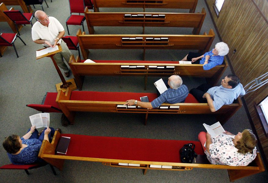Pat Henderson (top, left) leads a Bible study at Barataria Baptist Church. Residents along the stricken Gulf Coast are looking at the consequences of the ongoing oil spill and asking what religious good can come out of it.
