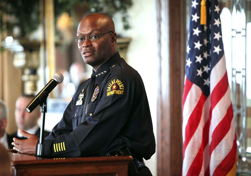 Dallas Police Chief David Brown speaks during a breakfast meeting Wednesday, July 7, 2010, of the North Texas Crime Commission at the Park Cities Club, in Dallas. Brown is resuming his public duties more than two weeks after his son was killed. (AP Photo/The Dallas Morning News, Jim Mahoney)