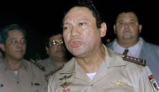 This May 1989 file photo shows General Manuel Antonio Noriega speaking to the press in Panama. (AP Photo)