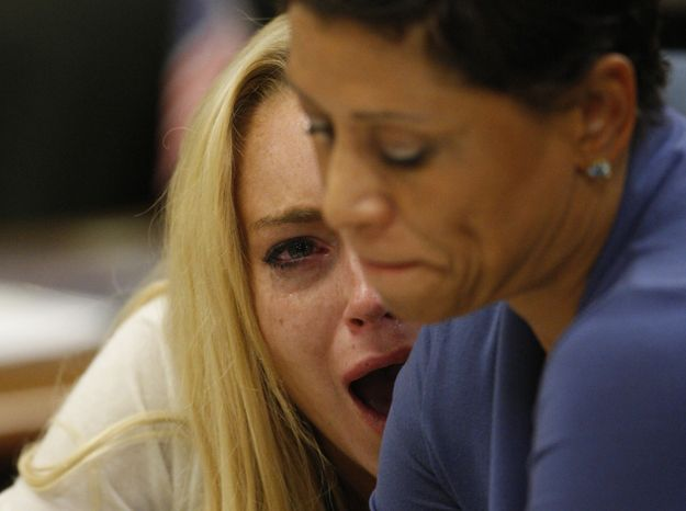 Actress Lindsay Lohan, left, reacts with her attorney Shawn Chapman Holley after the sentencing by Superior Court Judge Marsha Reve during a hearing in Beverly Hills, Calif., Tuesday, July 6, 2010. The judge sentenced Lindsay Lohan to 90 days in jail. (AP Photo/David McNew, Pool)