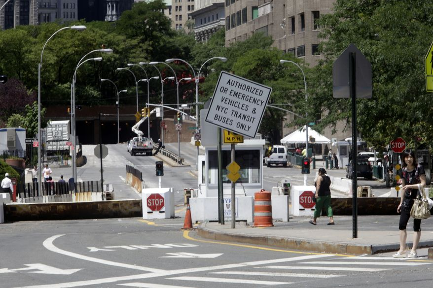 This Thursday, July 1, 2010 photo shows a sign warning vehicles that Park Row in lower Manhattan is closed to traffic. Following the Sept. 11, 2001, terror attacks, the New York Police Department barricaded off its headquarters. (AP Photo/Mary Altaffer)
