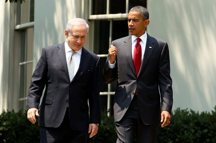 """President Obama confers with Israeli leader Benjamin Netanyahu after a White House meeting Tuesday. """"The bond between the United States and Israel is unbreakable,"""" Mr. Obama said. (Bloomberg)"""
