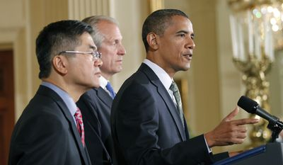 President Obama, right, with Boeing President, Chairman and CEO Jim McNerney, Jr., center, and Commerce Secretary Gary Locke, left, speaks about exports, jobs, and the economy, Wednesday, July 7, 2010, in the East Room of the White House in Washington. (AP Photo/Pablo Martinez Monsivais)