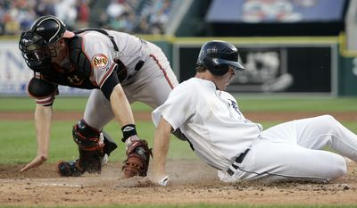 ASSOCIATED PRESS Detroit Tigers' Brennan Boesch, right, beats the tag from Baltimore Orioles catcher Matt Wieters to score from second base on a single by Carlos Guillen in the fifth inning of a baseball game Wednesday, July 7, 2010, in Detroit.