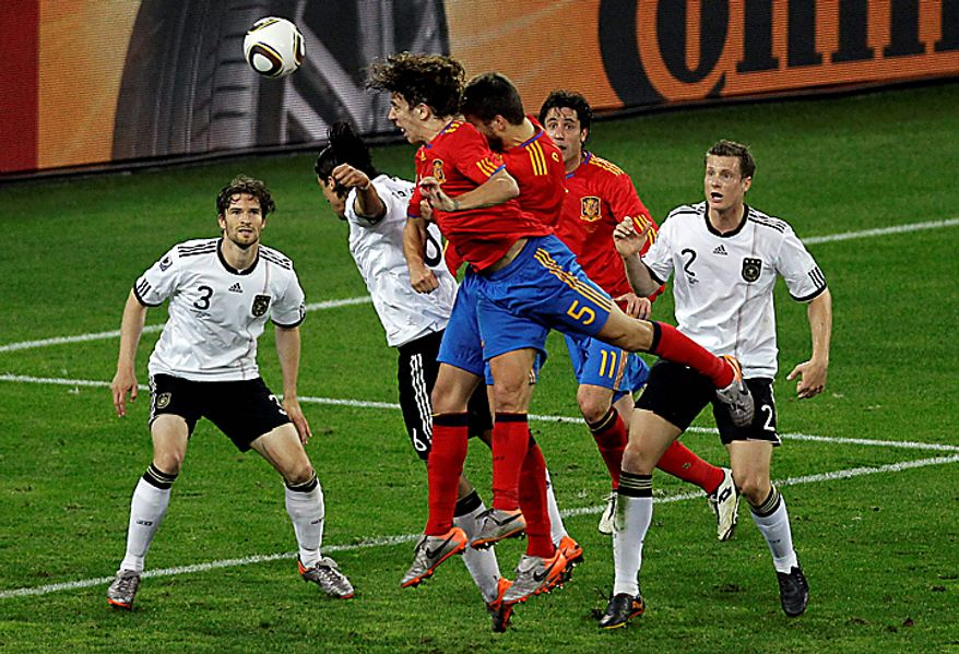 Spain's Carles Puyol, front, heads the ball to score a goal during the World Cup semifinal soccer match between  Germany and Spain at the stadium in Durban, South Africa, Wednesday, July 7, 2010..  (AP Photo/Hassan Ammar)
