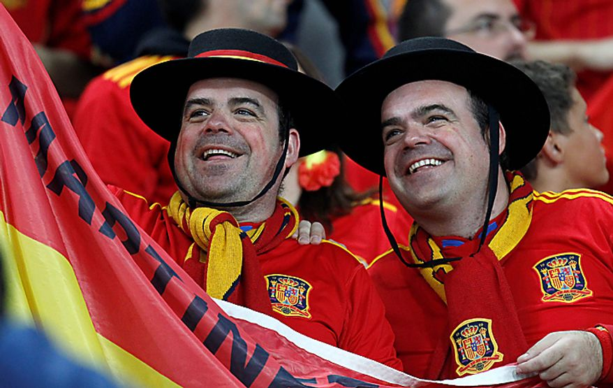 Spain supporters wait for the start of the World Cup semifinal soccer match between  Germany and Spain at the stadium in Durban, South Africa, Wednesday, July 7, 2010.  (AP Photo/Luca Bruno)