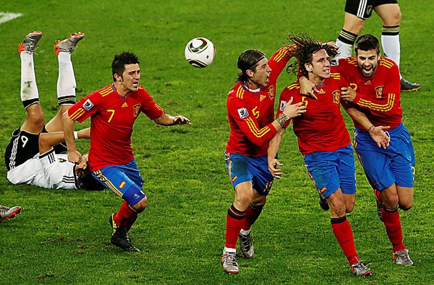 Spain's Carles Puyol, second from right, celebrates after scoring a goal with teammates Gerard Pique, right, Carles Puyol, third from right, and David Villa, second from left, during the World Cup semifinal soccer match between  Germany and Spain at the Moses Mabhida stadium in Durban, South Africa, Wednesday July 7, 2010. Spain won 1-0.(AP Photo/Themba Hadebe)